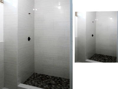 gray-tile-shower-with-black-pebble-tile-shower-pan