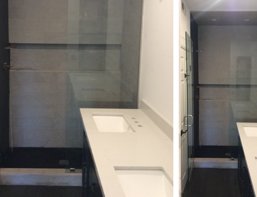 Shower Featuring Large White Ceramic Tiles