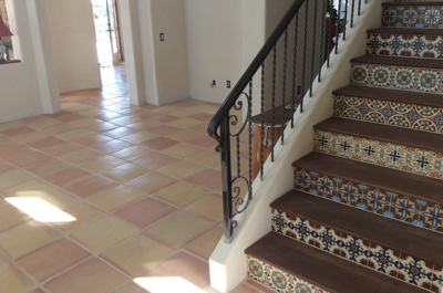 terracotta-tile-flooring-with-custom-tile-design-stairs